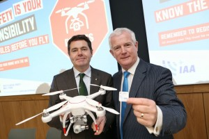 17/12/2015 NO REPRO FEE, PIC MAXWELLS/JULIEN BEHAL The Irish Aviation Authority (IAA) today announced new Drone legislation which includes the mandatory registration of all drones weighing 1Kg or more from Monday 21st December 2015.Picture shows Minister for Transport,Trade and Tourism Paschal Donohoe TD with Ralph James IAA Director Safety Regulation holding a drone in the offices of the IAA in Dublin.From 21st December all drones weighing 1kg or more must be registered with the IAA via www.iaa.ie/drones MORE INFO CONTACT Dave Curtin 086-2832123 PIC MAXWELLS/NO FEE