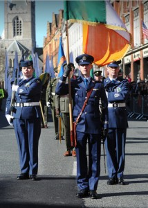 E-Lt Ó'Briain, a Great Grandson of Cathal Brugha, carrying the national colours which led the parade with Sgt Kane & Sgt Dwyer (IAC)