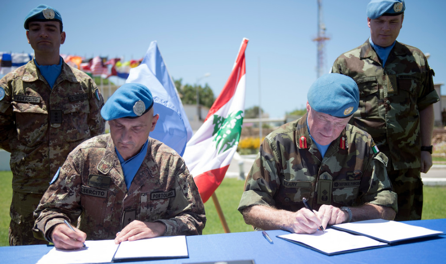 Signing the  transfer of authority from Major General Portolano to Major General Michael Beary
